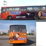 A full bus wrap.  All the people are eating snickers (and are see through graphics).  I like the guy in the back reaching for the person hanging on for dear life.  A cool effect!  3D effects are great tools for getting your ad noticed.  Call us!  How might we design a bus ad for your business?