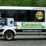 "Continental Home Centers on a Charllote ""EATRAN"" bus."